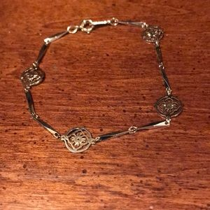 Avon Goldtone Floral Medallion Bracelet
